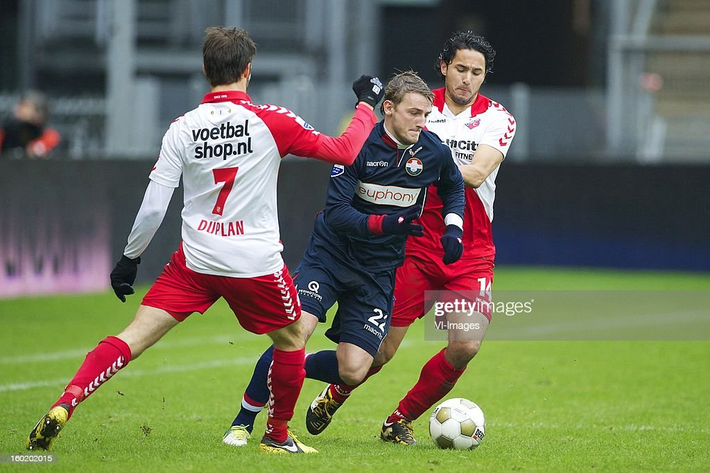 Edouard Duplan of FC Utrecht, Jens Podevijn of Willem II, Mark van der Maarel of FC Utrecht during the Dutch Eredivise match between FC Utrecht and Willem II at the Galgenwaard Stadium on January 27, 2013 in Utrecht, The Netherlands.