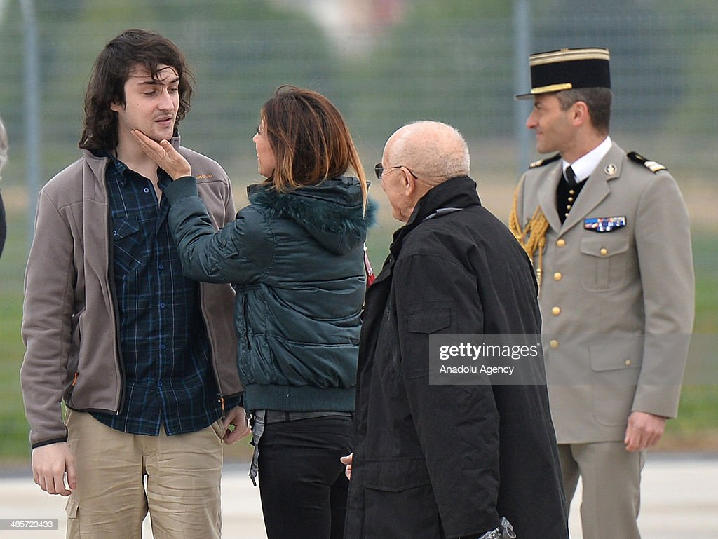 Edouard Elias a released French hostage is welcomed by his family members upon his arrival at the Villacoublay military airbase on April 20 2014 in...