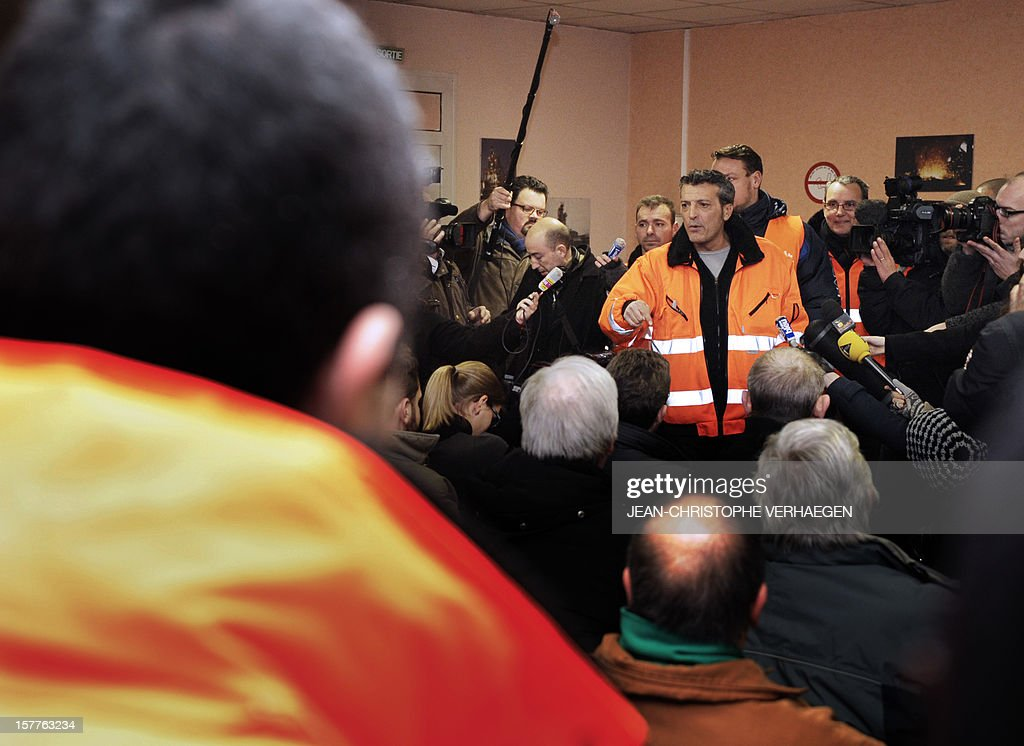 Edouard Martin (C), French CFDT union representative of the ArcelorMittal plant in Florange addresses the plant's employees occupying the blast-furnaces of the site, on December 6, 2012 in Florange, one day after a meeting with French Prime minister. French local newspaper Le Republicain Lorrain and other medias revealed that either Russian Severstal or Belgian CMI steel groups were reportedly the investors ready and willing to put 400 million euros ($515 million) into the Florange steel plant, at the centre of a dispute between the owner ArcelorMittal and the government.