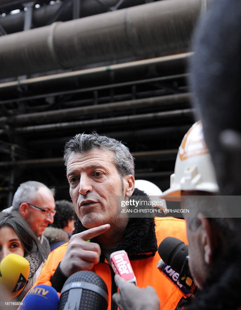 Edouard Martin (LC), French CFDT union representative of the ArcelorMittal plant in Florange speaks to the press as employees occupy the blast-furnaces of the site, on December 6, 2012 in Florange, one day after a meeting with French Prime minister. French local newspaper Le Republicain Lorrain and other medias revealed that either Russian Severstal or Belgian CMI steel groups were reportedly the investors ready and willing to put 400 million euros ($515 million) into the Florange steel plant, at the centre of a dispute between the owner ArcelorMittal and the government.