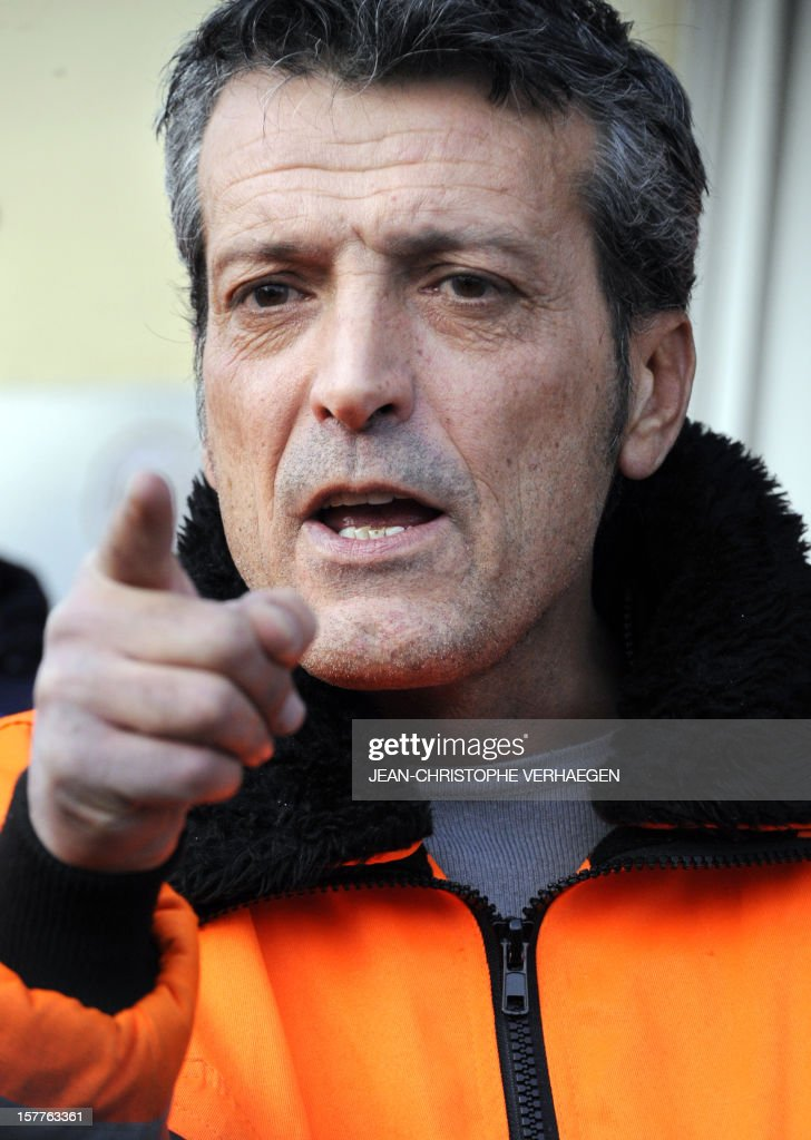 Edouard Martin (LC), French CFDT union representative of the ArcelorMittal plant in Florange speaks to the press as employees occupy the blast-furnaces of the site, on December 6, 2012 in Florange, one day after a meeting with French Prime minister. French local newspaper Le Republicain Lorrain and other medias revealed that either Russian Severstal or Belgian CMI steel groups were reportedly the investors ready and willing to put 400 million euros ($515 million) into the Florange steel plant, at the centre of a dispute between the owner ArcelorMittal and the government. AFP PHOTO JEAN-CHRISTOPHE VERHAEGEN