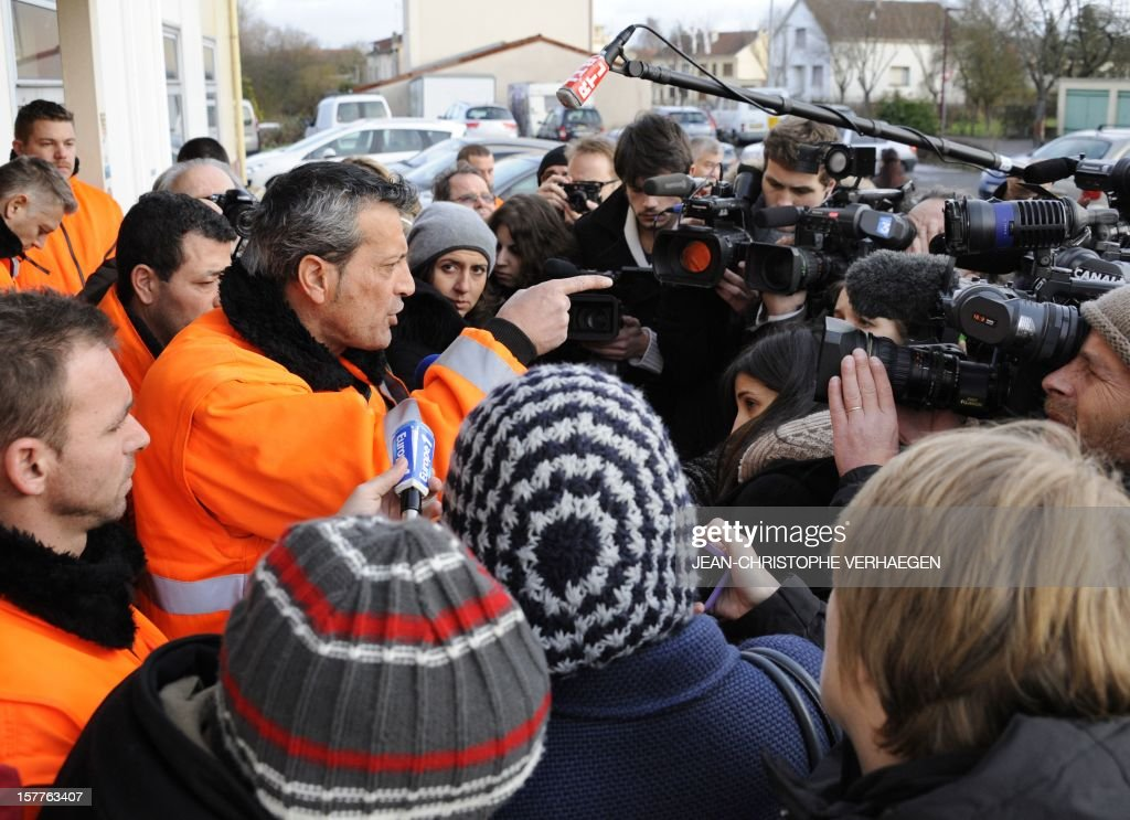 Edouard Martin (L), French CFDT union representative of the ArcelorMittal plant in Florange speaks to the press as employees occupy the blast-furnaces of the site, on December 6, 2012 in Florange, one day after a meeting with French Prime minister. French local newspaper Le Republicain Lorrain and other medias revealed that either Russian Severstal or Belgian CMI steel groups were reportedly the investors ready and willing to put 400 million euros ($515 million) into the Florange steel plant, at the centre of a dispute between the owner ArcelorMittal and the government.
