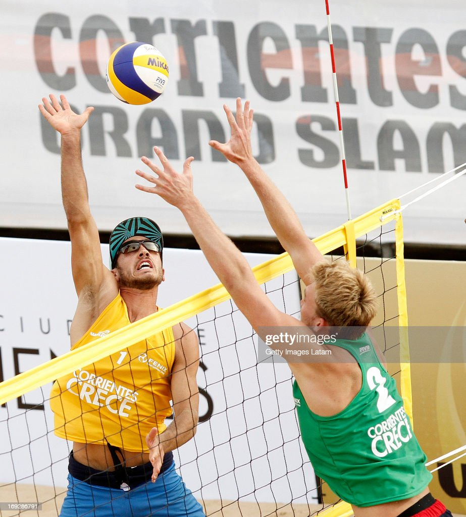 Edouard Redmann (in Yellow) of France smashes the ball as Alexander Walkenhorst (in Green) of Germany tries to block during a match between France and Germany as part of day one of Corrientes Grand Slam of FIVB World Tour at Arazaty Beach on May 22, 2013 in Corrientes, Argentina.