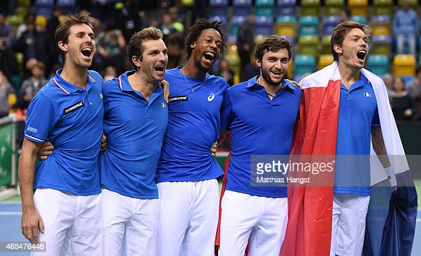 Edouard RogerVasselin Julien Benneteau Gael Monfils Gilles Simon and Nicolas Mahut of France celebrate after the decisive doubles match during day...