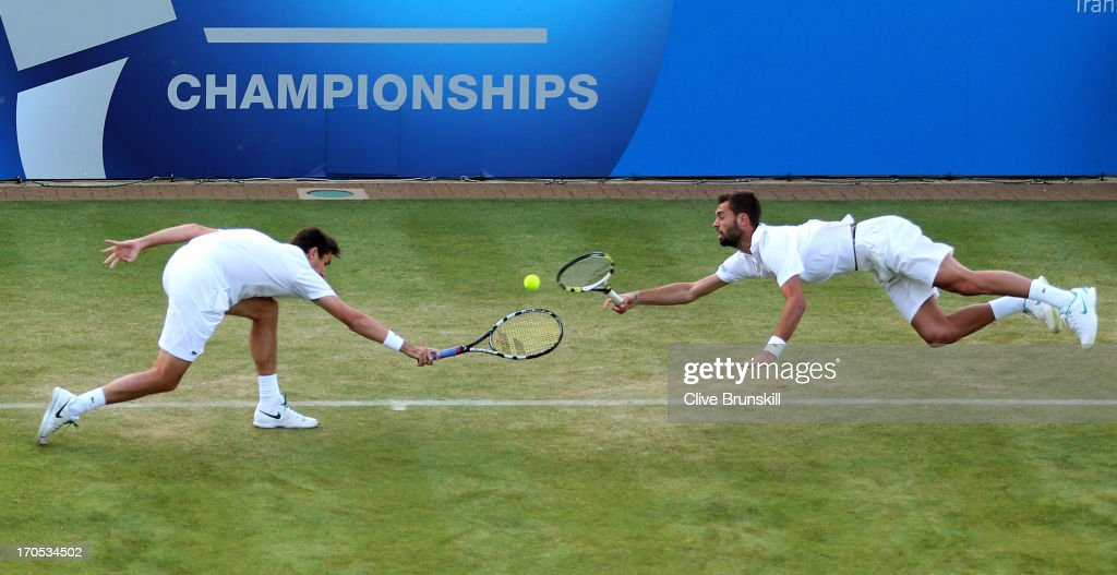 Edouard Roger-Vasselin of France (L) and Benoit Paire of France in action during the Men's Doubles second round match against Colin Fleming of Great Britain and Jonathan Marray of Great Britain on day four of the AEGON Championships at Queens Club on June 13, 2013 in London, England.
