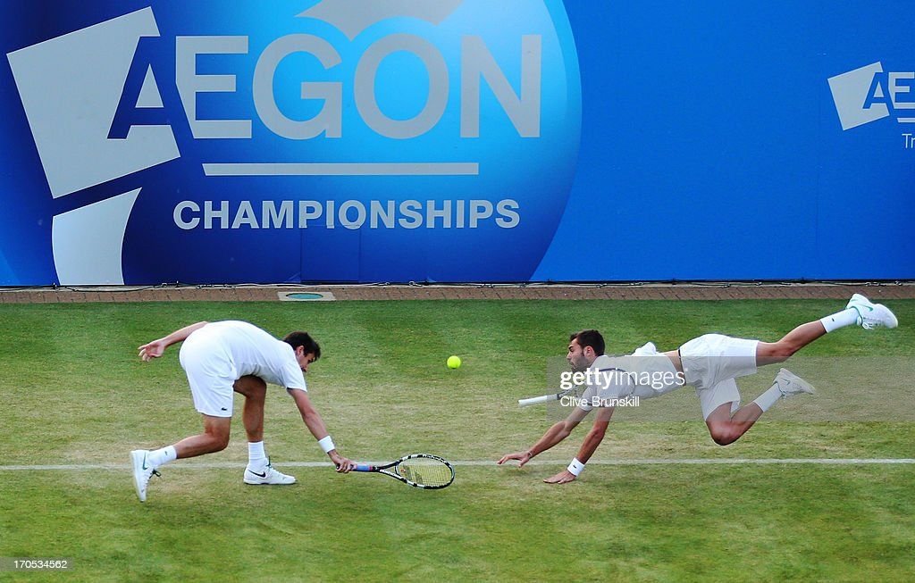 <a gi-track='captionPersonalityLinkClicked' href=/galleries/search?phrase=Edouard+Roger-Vasselin&family=editorial&specificpeople=4312893 ng-click='$event.stopPropagation()'>Edouard Roger-Vasselin</a> of France (L) and <a gi-track='captionPersonalityLinkClicked' href=/galleries/search?phrase=Benoit+Paire&family=editorial&specificpeople=6999938 ng-click='$event.stopPropagation()'>Benoit Paire</a> of France in action during the Men's Doubles second round match against Colin Fleming of Great Britain and Jonathan Marray of Great Britain on day four of the AEGON Championships at Queens Club on June 13, 2013 in London, England.