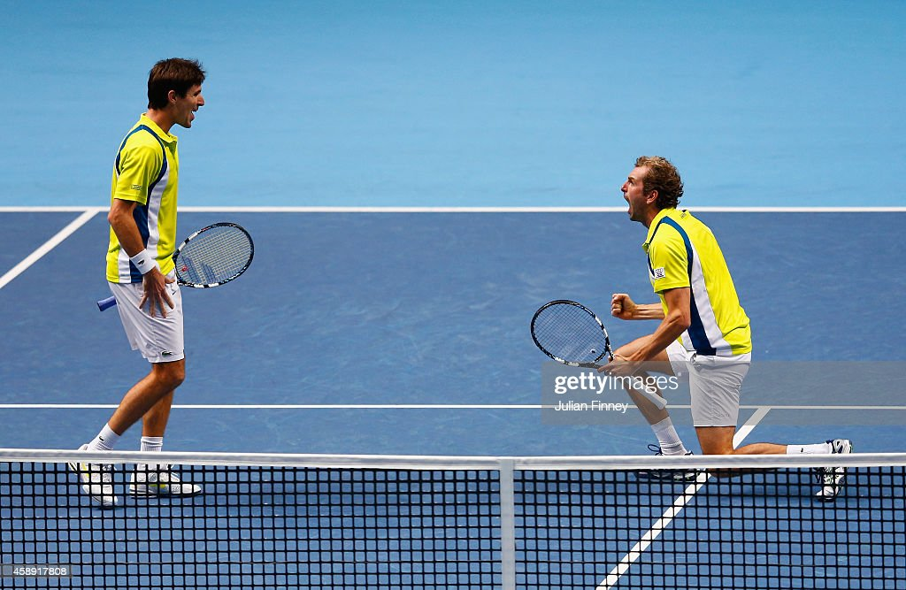 <a gi-track='captionPersonalityLinkClicked' href=/galleries/search?phrase=Edouard+Roger-Vasselin&family=editorial&specificpeople=4312893 ng-click='$event.stopPropagation()'>Edouard Roger-Vasselin</a> of France and <a gi-track='captionPersonalityLinkClicked' href=/galleries/search?phrase=Julien+Benneteau&family=editorial&specificpeople=228097 ng-click='$event.stopPropagation()'>Julien Benneteau</a> of France celebrate match point in the round robin doubles match against Ivan Dodig of Croatia and Marcelo Melo of Brazil on day five of the Barclays ATP World Tour Finals at O2 Arena on November 13, 2014 in London, England.
