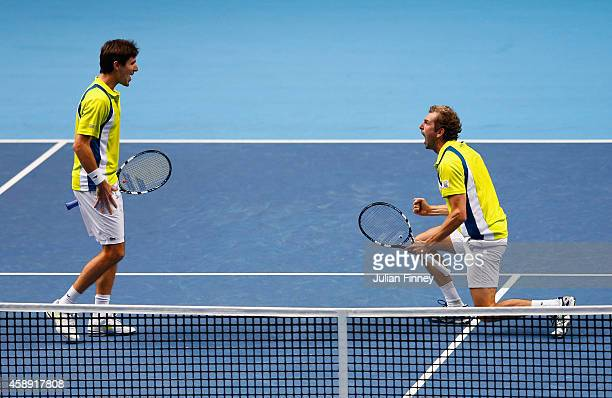 Edouard RogerVasselin of France and Julien Benneteau of France celebrate match point in the round robin doubles match against Ivan Dodig of Croatia...