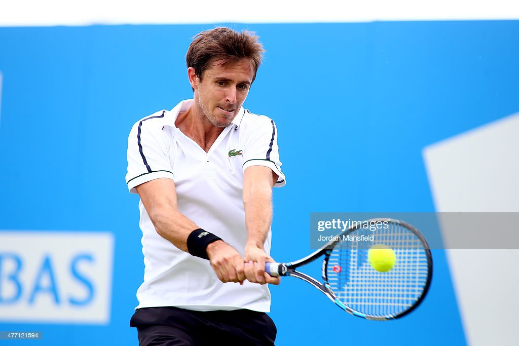 Edouard Roger-Vasselin of France plays a backhand during his Qualification match of the Aegon Championships against Simone Bolelli of Italy at Queens Club on June 14, 2015 in London, England.