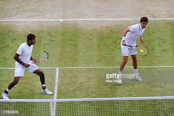 Edouard RogerVasselin of France plays a backhand next to teammate Rohan Bopanna of India during the Gentlemen's Doubles semi final match against Bob...