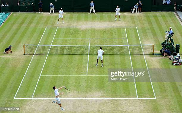 Edouard RogerVasselin of France returns a shot next to teammate Rohan Bopanna of India during the Gentlemen's Doubles semi final match against Mike...