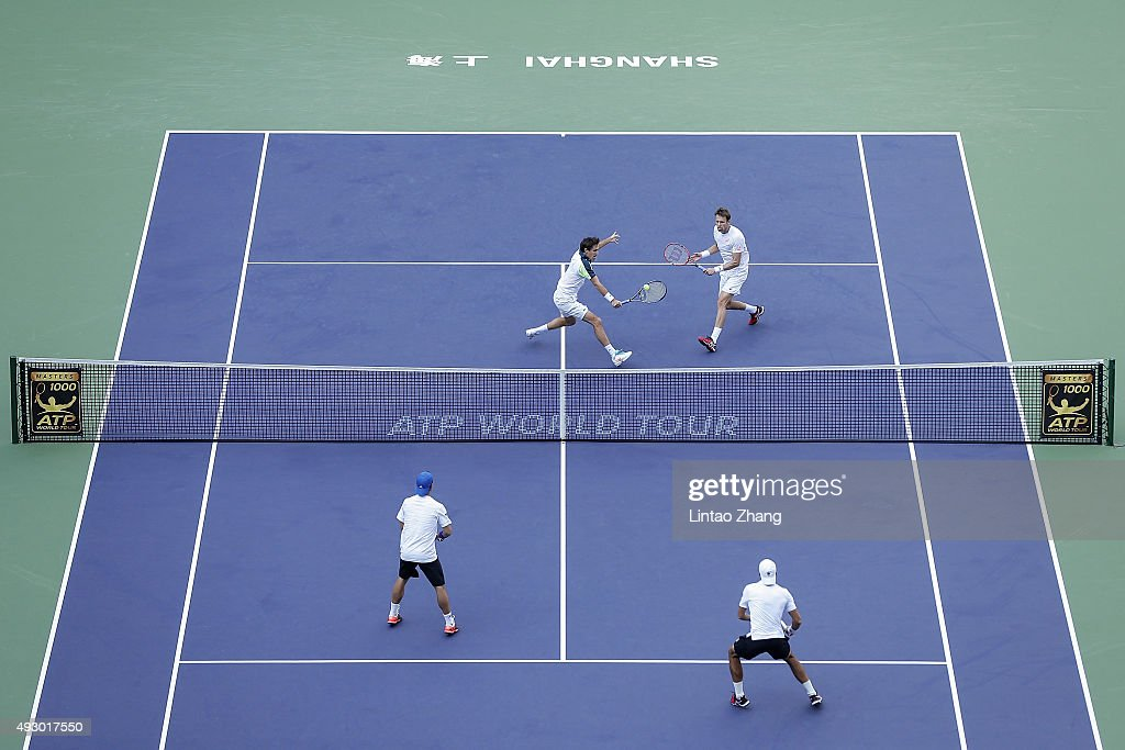Edouard Roger-Vasselin (Top-L) of France returns a shot with Daniel Nestor of Canada against Simone Bolelli and Fabio Fognini of Italy during their men's double semifinal on day 7 of Shanghai Rolex Masters at Qi Zhong Tennis Centre on October 17, 2015 in Shanghai, China.