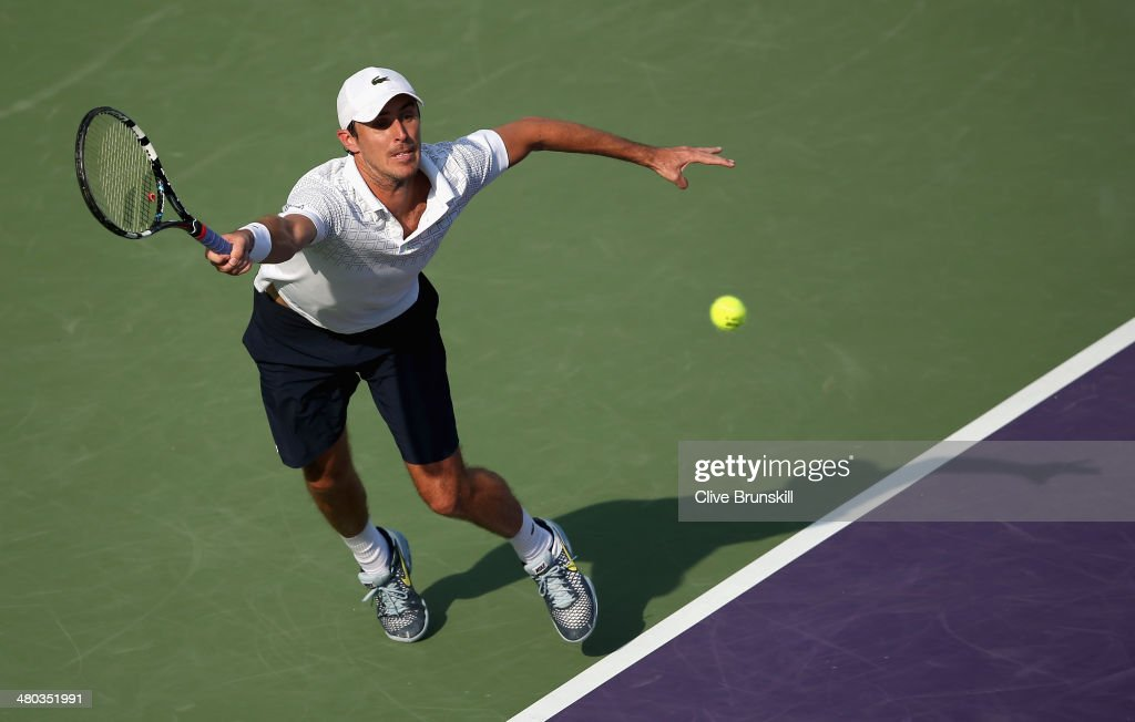 Edouard Roger-Vasselin of France stretches against Stanislas Wawrinka of Switzerland during their third round match during day 8 at the Sony Open at Crandon Park Tennis Center on March 24, 2014 in Key Biscayne, Florida.