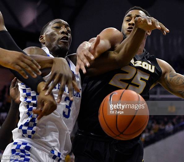 Edrice Adebayo of the Kentucky Wildcats and Russell Woods of the Missouri Tigers battle for a rebound during the first half at Mizzou Arena on...