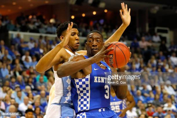 Edrice Adebayo of the Kentucky Wildcats handles the ball against Tony Bradley of the North Carolina Tar Heels in the first half during the 2017 NCAA...