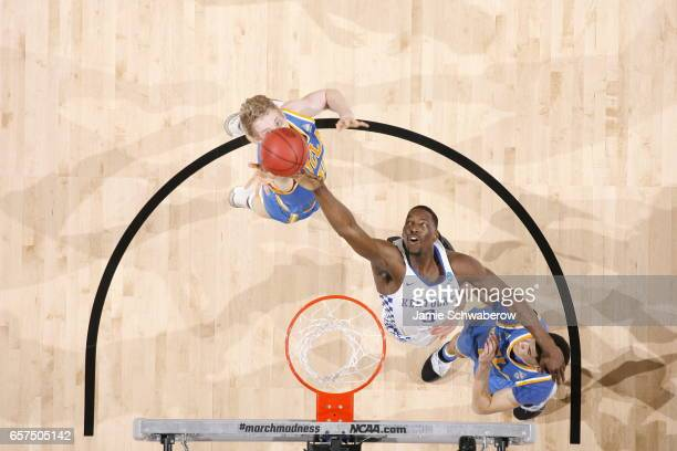 Edrice Adebayo of the University of Kentucky grabs a rebound against Thomas Welsh of UCLA during the 2017 NCAA Men's Basketball Tournament at...
