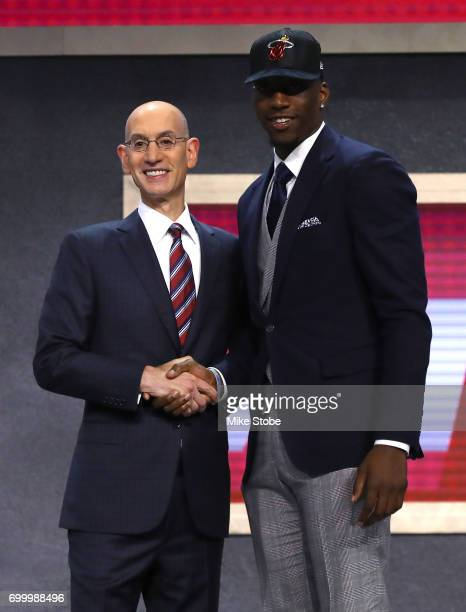 """Edrice """"Bam"""" Adebayo walks on stage with NBA commissioner Adam Silver after being drafted 14th overall by the Miami Heat during the first round of..."""