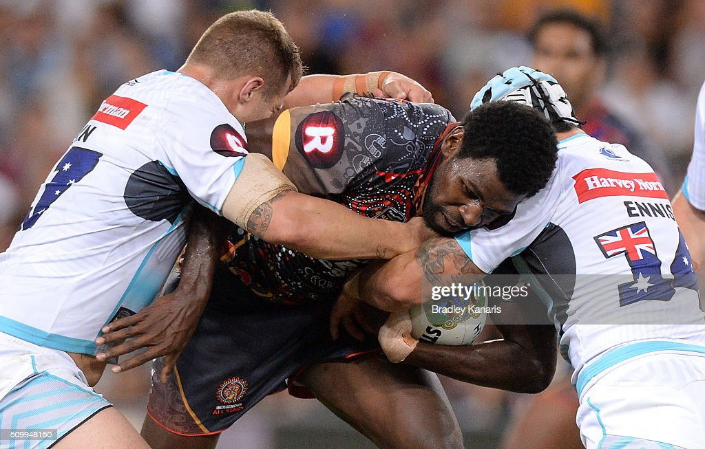 Edrick Lee of the Indigenous All Stars is tackled during the NRL match between the Indigenous All-Stars and the World All-Stars at Suncorp Stadium on February 13, 2016 in Brisbane, Australia.