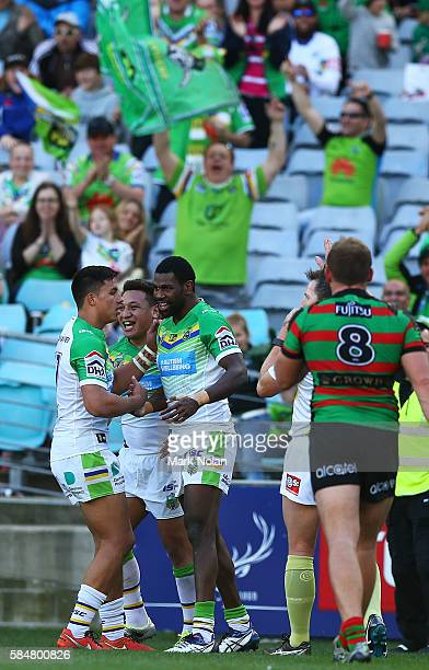 Edrick Lee of the Raiders celebrates a try with team mates during the round 21 NRL match between the South Sydney Rabbitohs and the Canberra Raiders...