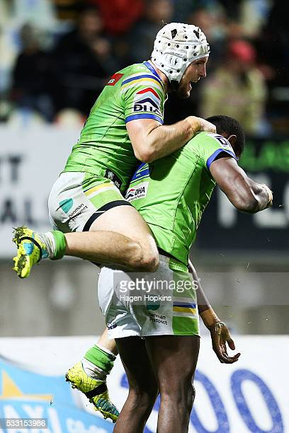 Edrick Lee of the Raiders celebrates his try with teammate Jarrod Croker of the Raiders during the round 11 NRL match between the New Zealand...