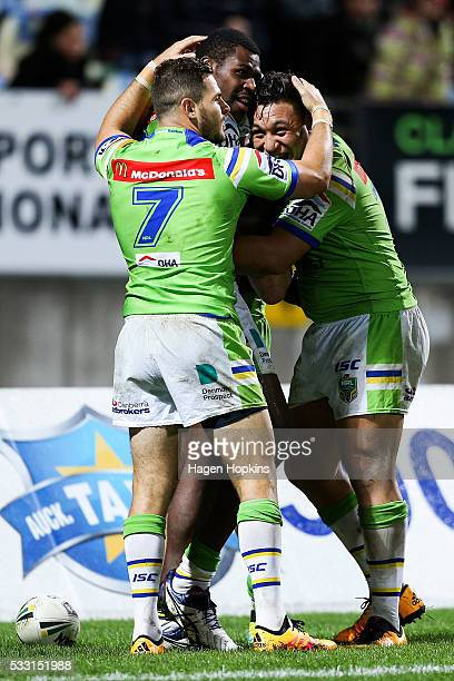 Edrick Lee of the Raiders celebrates his try with teammates Aidan Sezer and Josh Papalii during the round 11 NRL match between the New Zealand...
