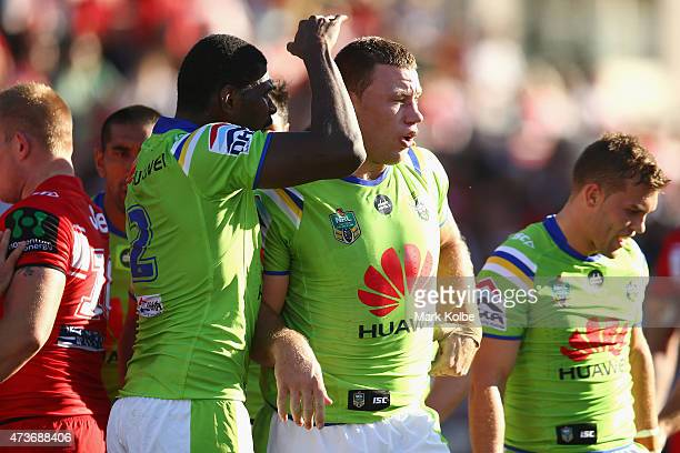 Edrick Lee of the Raiders congratulates Shannon Boyd of the Raiders as celebrates with his team mate after scoring a try during the round 10 NRL...