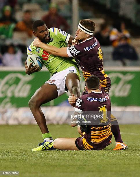 Edrick Lee of the Raiders is tackled during the round 12 NRL match between the Canberra Raiders and the Brisbane Broncos at GIO Stadium on May 30...