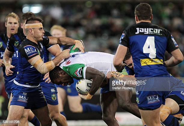 Edrick Lee of the Raiders is tackled during the round 12 NRL match between the Canberra Raiders and the Canterbury Bulldogs at GIO Stadium on May 29...