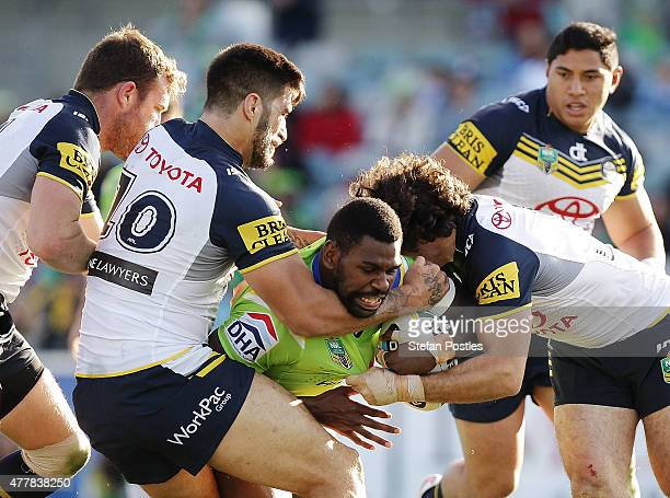 Edrick Lee of the Raiders is tackled during the round 15 NRL match between the Canberra Raiders and the North Queensland Cowboys at GIO Stadium on...