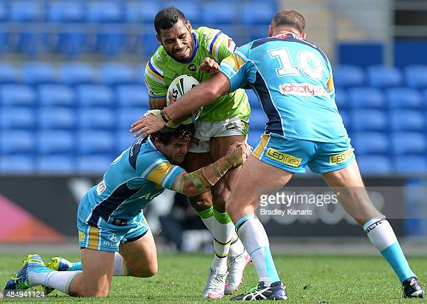 Edrick Lee of the Raiders is tackled during the round 24 NRL match between the Gold Coast Titans and the Canberra Raiders at Cbus Super Stadium on...