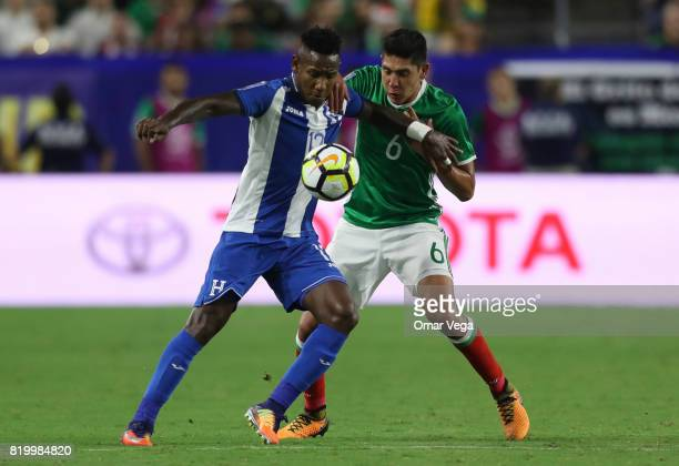 Edson Alvarez of Mexico and Oscar Boniek of Honduras fight for the ball during the CONCACAF Gold Cup 2017 quarterfinal match between Mexico and...