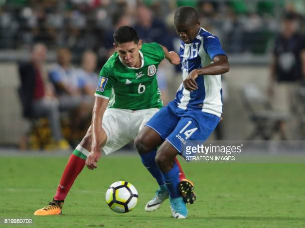 Edson Alvarez of Mexico competes for the ball with Boniek Garcia of Honduras during the CONCACAF Gold Cup 2017 quarterfinal match between Mexico and...