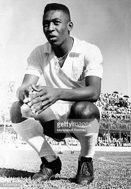 Edson Arantes do Nascimento also called Pele squatting on a football field 1961
