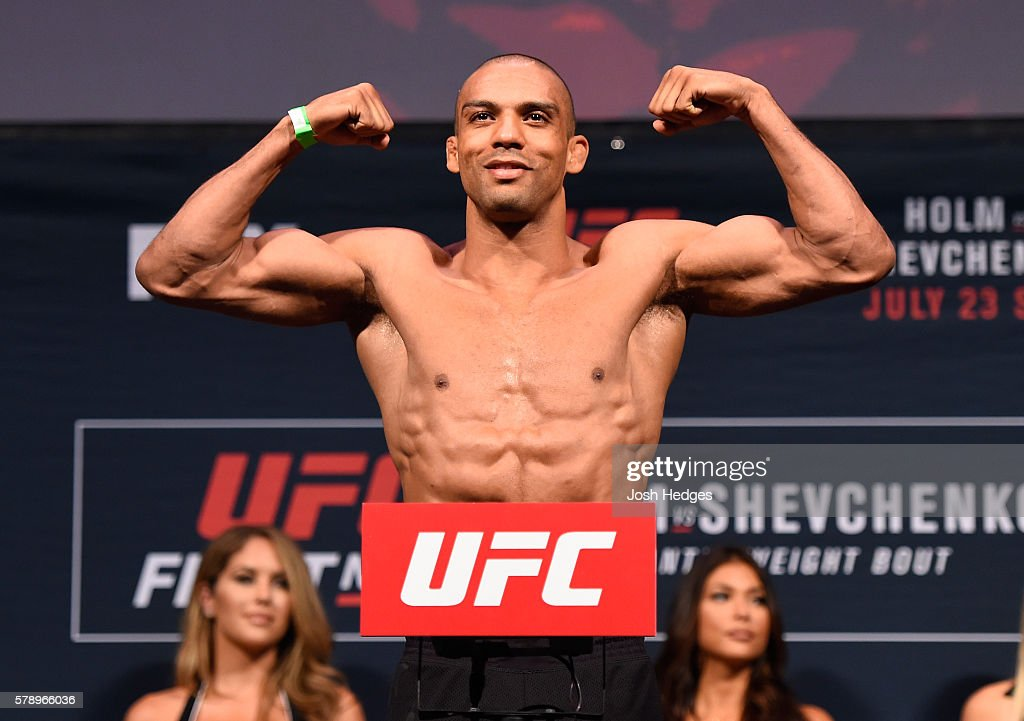 Edson Barboza of Brazil poses on the scale during the UFC weigh-in at the United Center on July 22, 2016 in Chicago, Illinois.