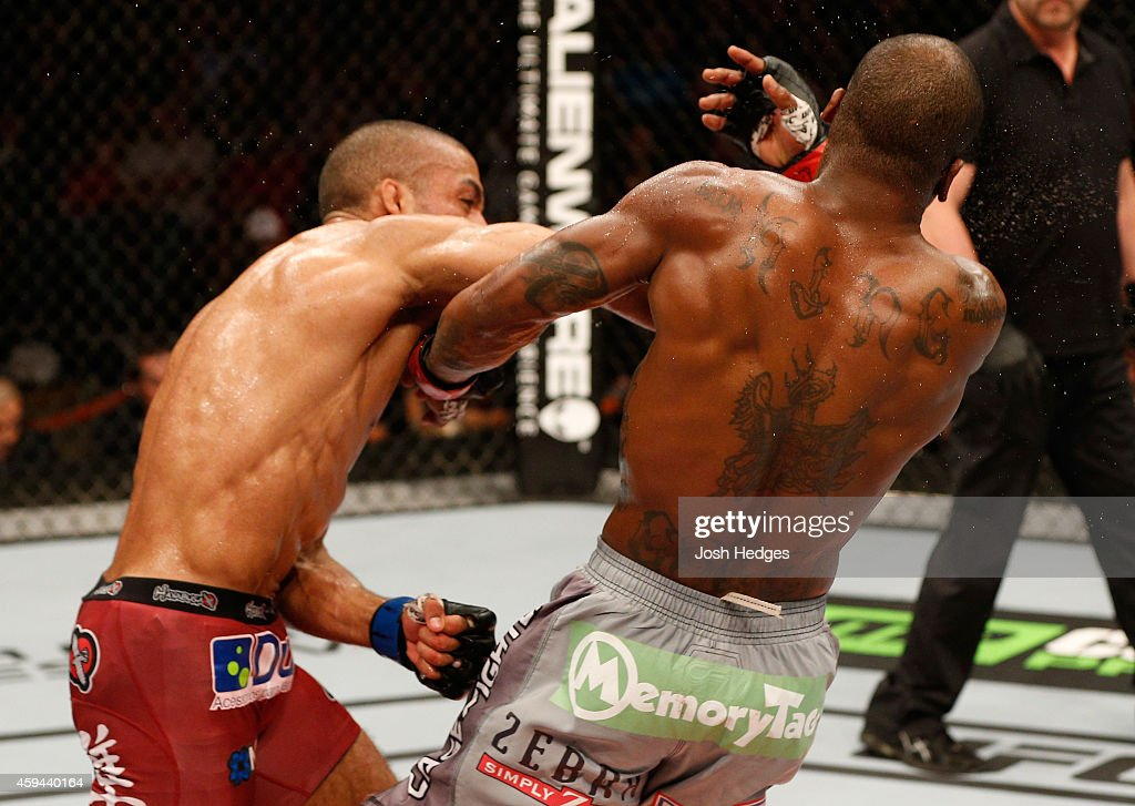 Edson Barboza of Brazil punches Bobby Green in their lightweight bout during the UFC Fight Night event at The Frank Erwin Center on November 22, 2014 in Austin, Texas.