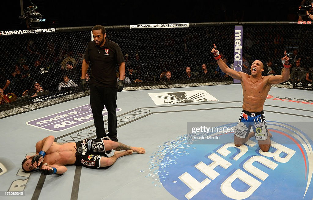 Edson Barboza (right) reacts to his victory over Rafaello Oliveira (left) in their lightweight fight during the UFC 162 event inside the MGM Grand Garden Arena on July 6, 2013 in Las Vegas, Nevada.