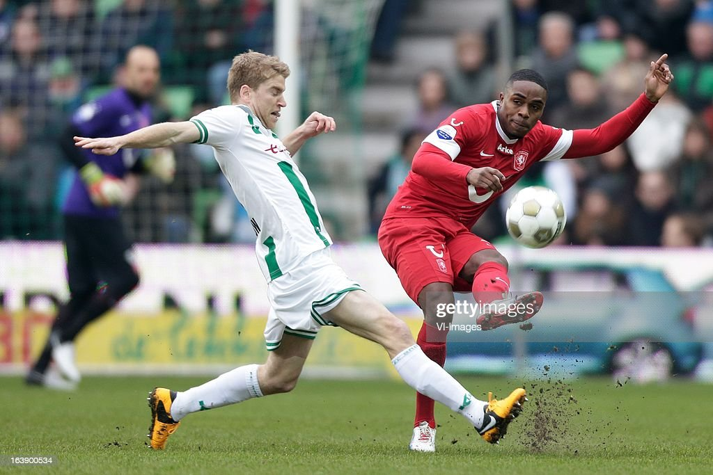 Edson Braafheid of FC Twente (R) Michael de Leeuw of FC Groningen (L) during the Dutch Eredivisie match between FC Groningen and FC Twente at the Euroborg Stadium on march 17, 2013 in Groningen, The Netherlands