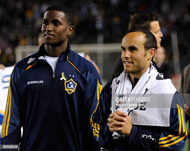 Edson Buddle and Landon Donovan of the Los Angeles Galaxy look at the stadium screen during a World Cup send off ceremony after their MLS soccer...