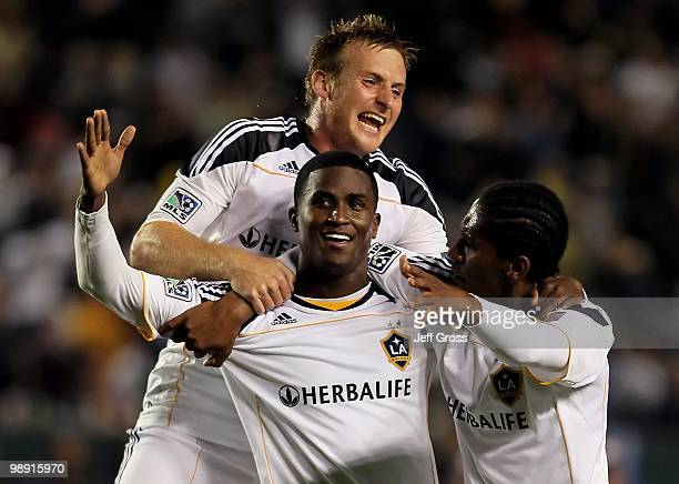 Edson Buddle Chris Birchall and Alex Cazumba of the Los Angeles Galaxy celebrate Buddle's goal in the second half against Real Salt Lake at the Home...