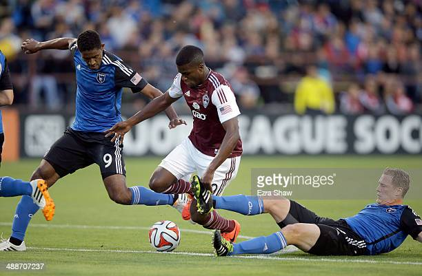 Edson Buddle of Colorado Rapids tries to dribble through Khari Stephenson and Ty Harden of San Jose Earthquakes at Buck Shaw Stadium on May 7 2014 in...