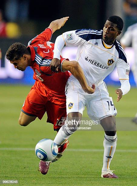 Edson Buddle of Los Angeles Galaxy controls the ball against Adrian Cann of Toronto FC during the first half of the MLS soccer match on May 15 2010...