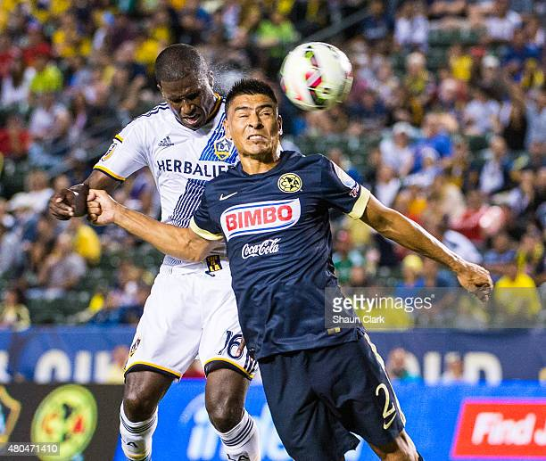 Edson Buddle of Los Angeles Galaxy heads the ball toward goal as Paolo Goltz of Club America defends during the International Champions Cup 2015...