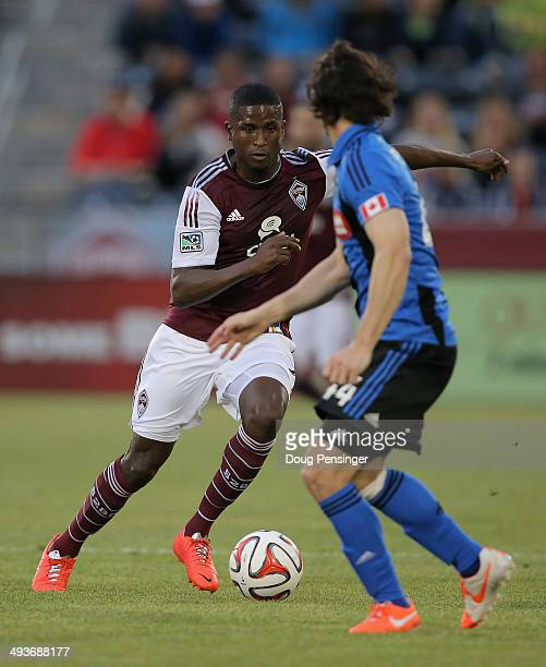 Edson Buddle of the Colorado Rapids controls the ball against Heath Pearce of the Montreal Impact at Dick's Sporting Goods Park on May 24 2014 in...