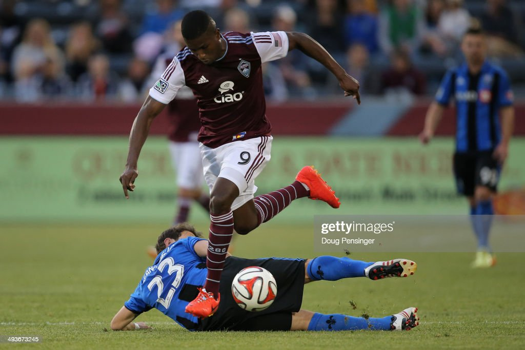 Edson Buddle #9 of the Colorado Rapids controls the ball against Hernan Bernardello #23 of the Montreal Impact at Dick's Sporting Goods Park on May 24, 2014 in Commerce City, Colorado.