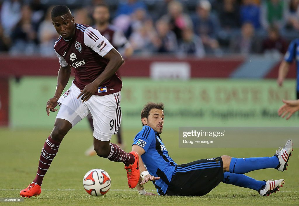 Edson Buddle #9 of the Colorado Rapids controls the ball against Hernan Bernardello #23 of the Montreal Impact at Dick's Sporting Goods Park on May 24, 2014 in Commerce City, Colorado. The Rapids defeated the Impact 4-1.