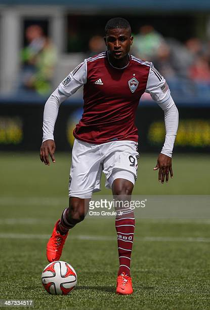 Edson Buddle of the Colorado Rapids dribbles against the Seattle Sounders FC at CenturyLink Field on April 26 2014 in Seattle Washington
