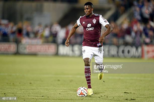 Edson Buddle of the Colorado Rapids dribbles the ball up the field during an MLS match against the Columbus Crew at Dick's Sporting Goods Park on...