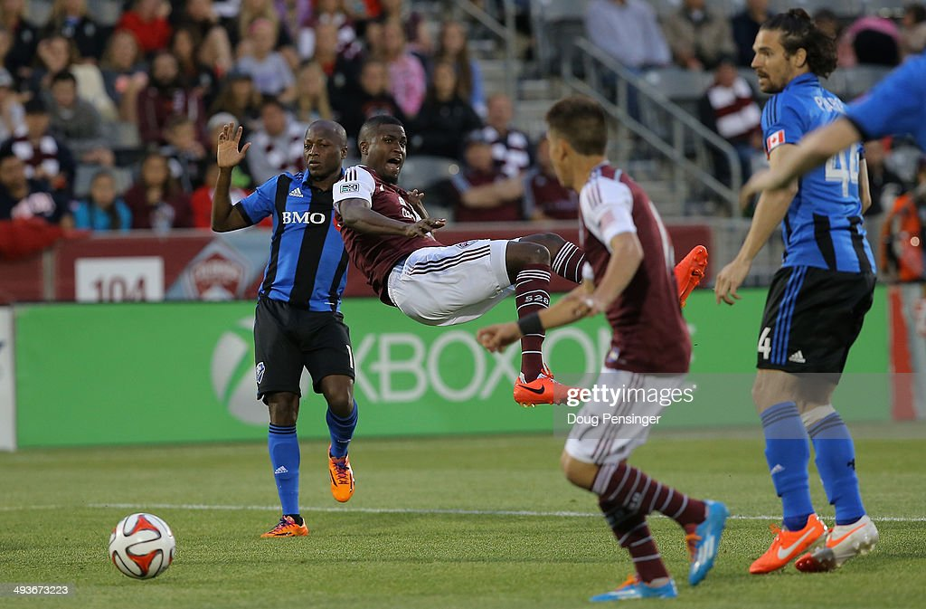 Edson Buddle #9 of the Colorado Rapids is fouled by Sanna Nyassi #11 of the Montreal Impact in the penalty box in the third minute at Dick's Sporting Goods Park on May 24, 2014 in Commerce City, Colorado. The resulting peanlty kick by Dillon Powers #8 of the Colorado Rapids scored and gave the Rapids a 1-0 lead.