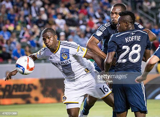 Edson Buddle of the Los Angeles Galaxy breaks free for a shot on goal as Gershon Koffie and Kendall Waston of Vancouver FC defend during the MLS...