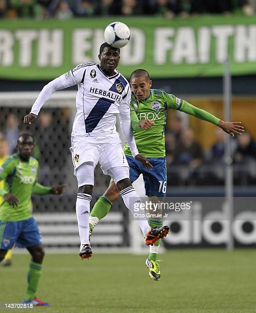 Edson Buddle of the Los Angeles Galaxy heads the ball against David Estrada of the Seattle Sounders at CenturyLink Field on May 2 2012 in Seattle...